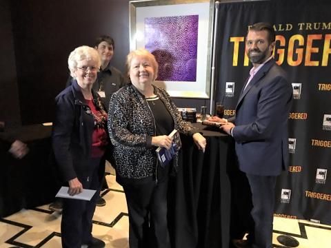 Trudi Dailey, Linda Buckardt and Donald Trump, Jr. at the book signing where Don Jr. was handed him a letter inviting him to  be a speaker at our Sept. RCSCA meeting.